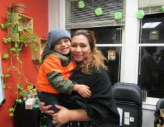 Rosa, a founding member of El Cafesito and her son.